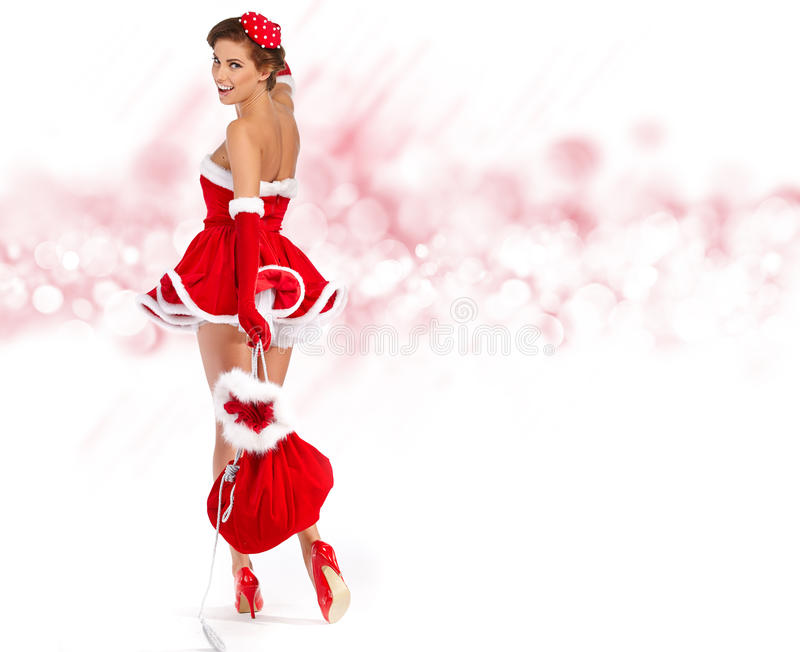 Девушка нося одежды Санта Клауса стоковая фотография rf