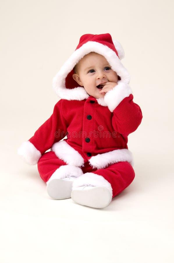 девушка одетьнная costume santa младенца вверх стоковые фото