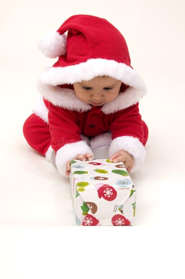 девушка одетьнная costume santa младенца вверх стоковое изображение