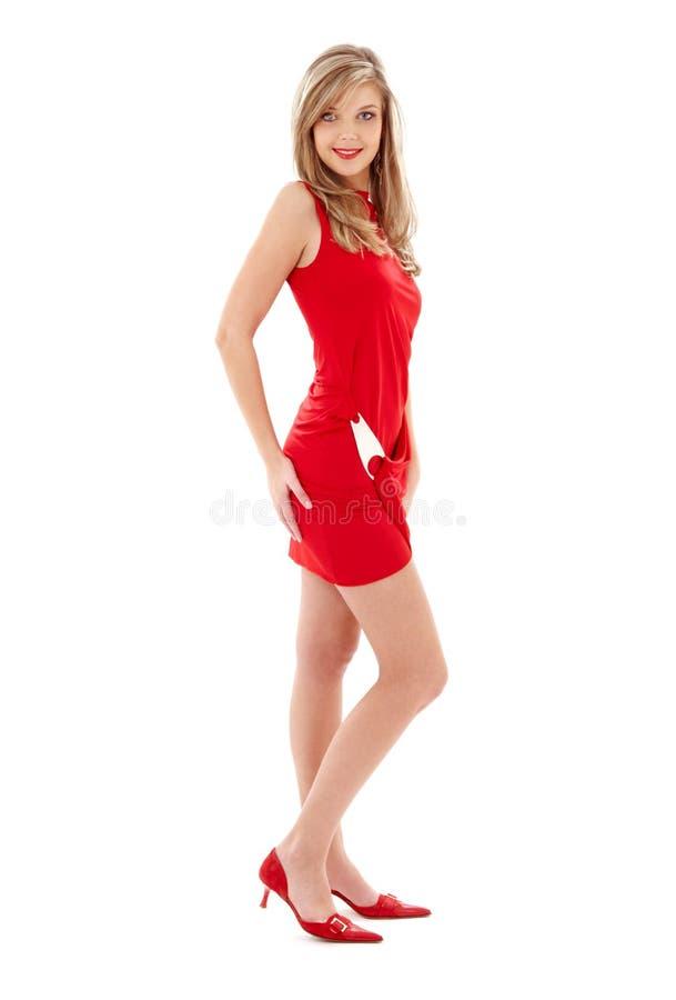девушка платья кренит высокие симпатичные красные ботинки стоковое фото