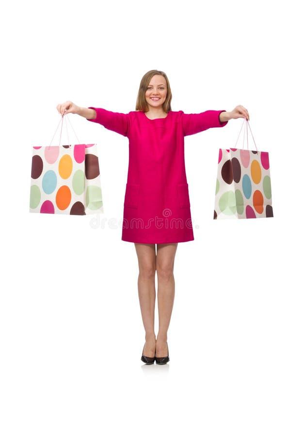 Девушка покупателя в розовом платье держа полиэтиленовые пакеты изолированный на whit стоковые изображения