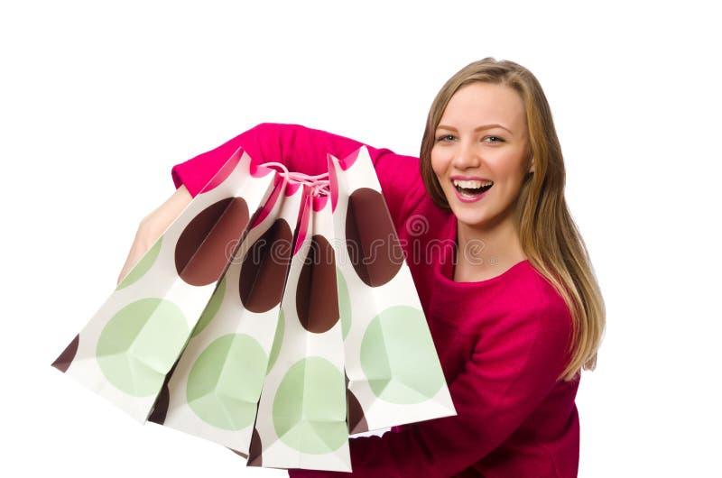 Девушка покупателя в розовом платье держа полиэтиленовые пакеты изолированный на whit стоковые фотографии rf