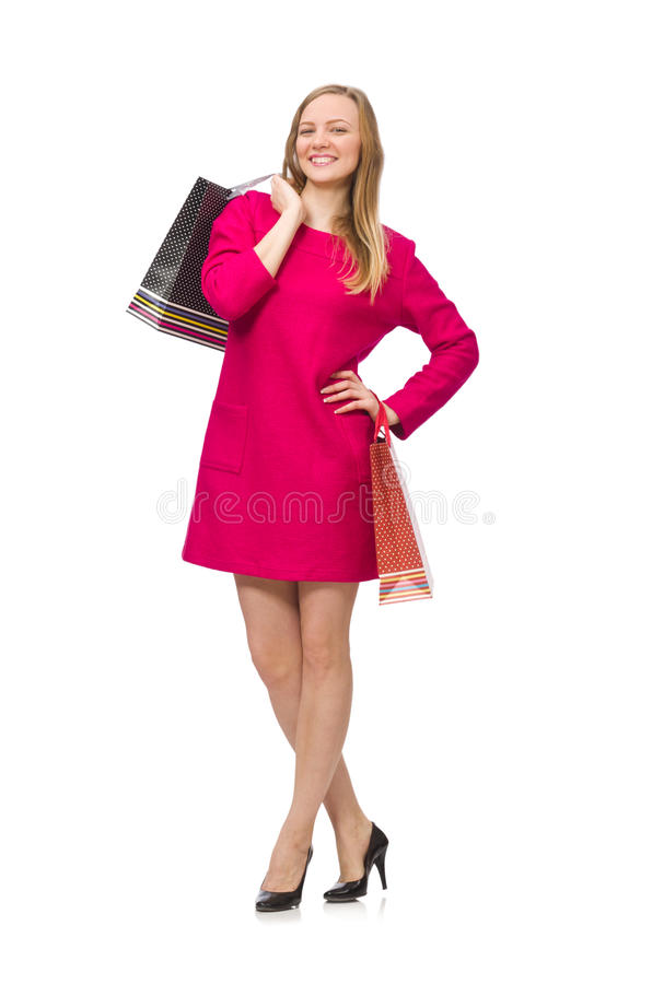 Девушка покупателя в розовом платье держа полиэтиленовые пакеты изолированный на whit стоковые изображения rf