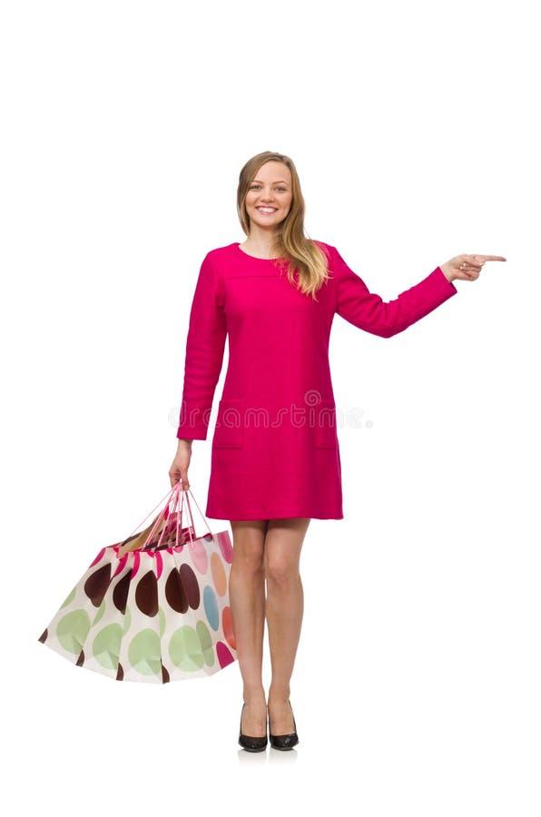 Девушка покупателя в розовом платье держа полиэтиленовые пакеты стоковая фотография