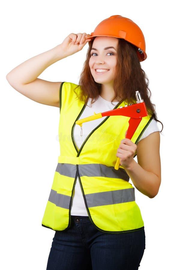 Девушка построитель с механически оружием для заклепок стоковое изображение