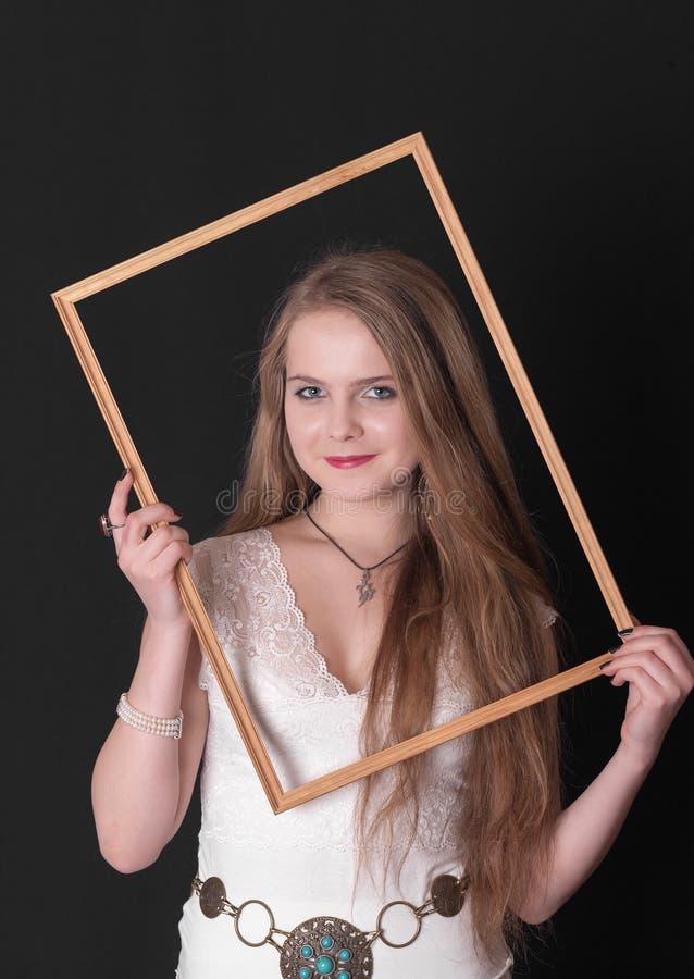 Девушка подростка в рамке стоковые фотографии rf