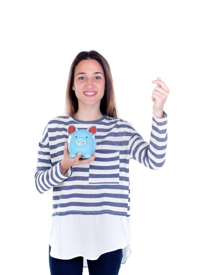 Девушка подростка с голубой копилкой стоковая фотография rf