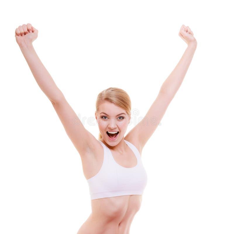 Девушка подходящей женщины спорта фитнеса счастливая празднуя изолированный успех стоковое фото