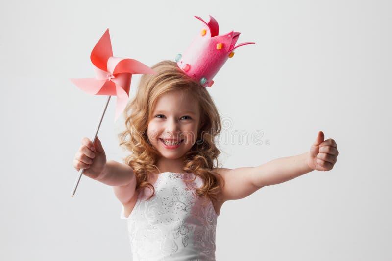 Девушка принцессы конфеты с pinwheel стоковое изображение rf