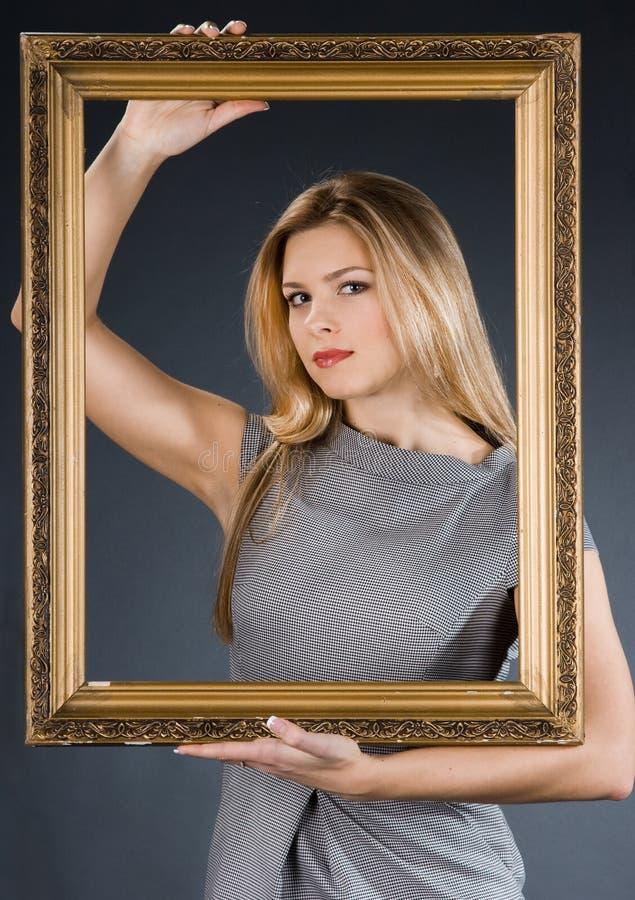 девушка рамки золотистая стоковая фотография