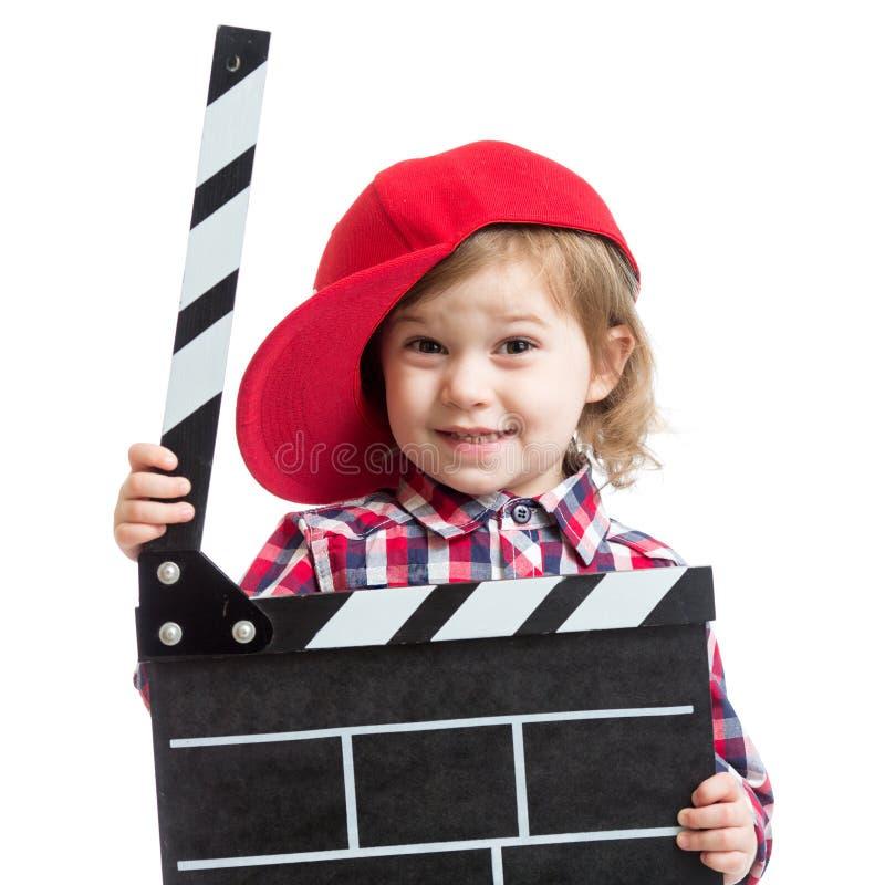 Девушка ребенка держа нумератор с хлопушкой в руках изолированный стоковые фотографии rf