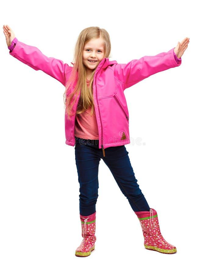 Девушка ребенка представляя моду на белой предпосылке стоковая фотография rf