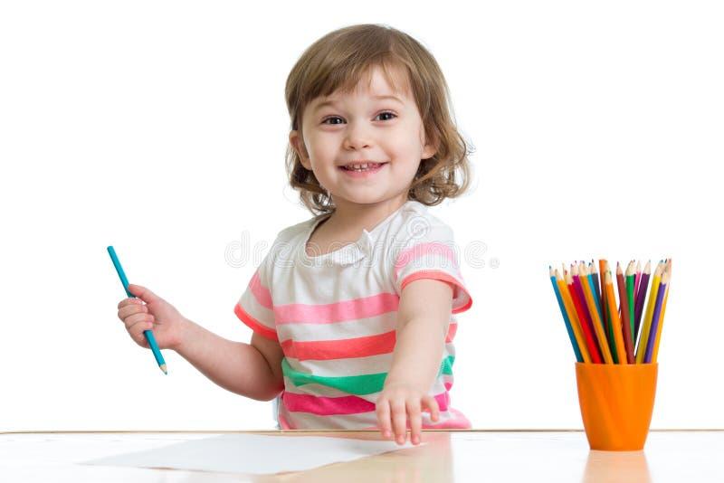 Девушка ребенк с карандашами стоковые фотографии rf