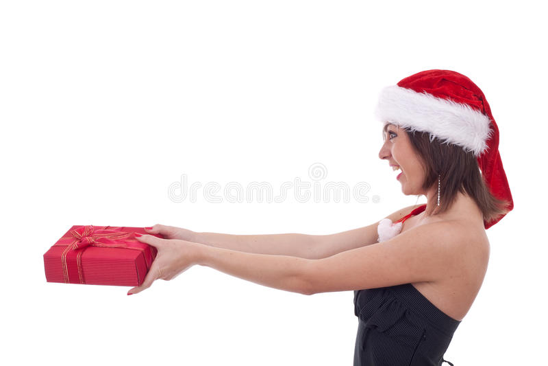 девушка рождества давая настоящий момент стоковая фотография