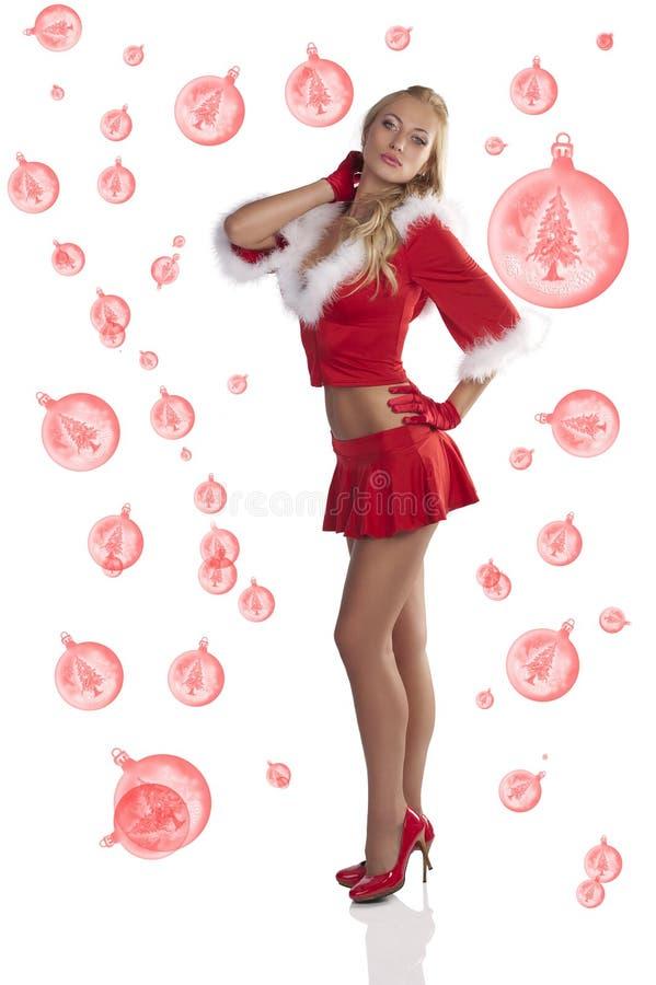 девушка рождества представляя сексуальный оглушать стоковая фотография
