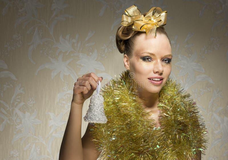 Девушка рождества с меньшим колоколом стоковые фотографии rf