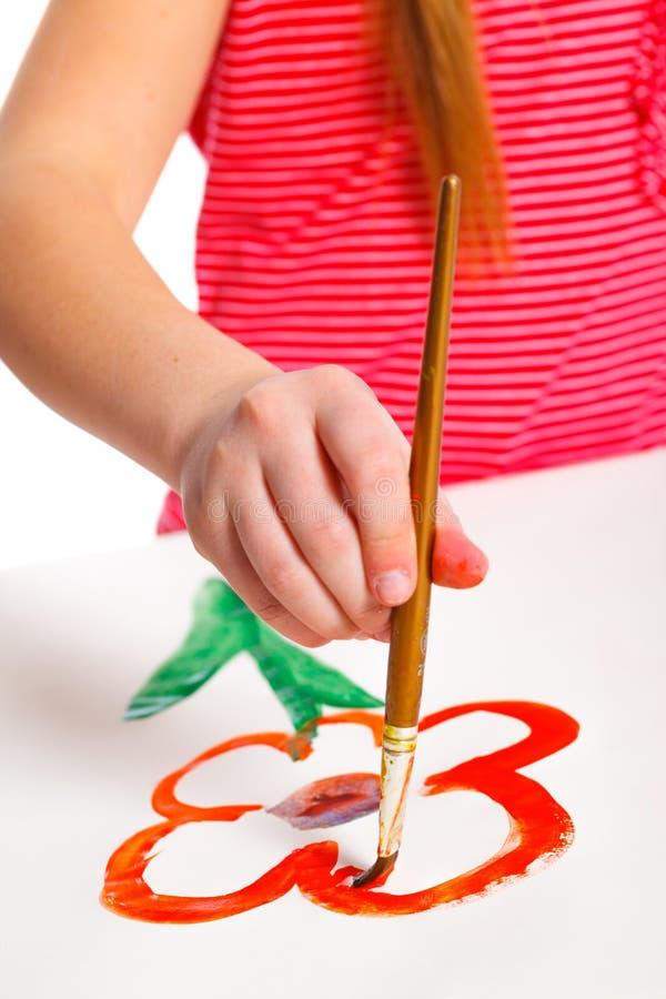 Девушка руки с краской стоковое фото rf
