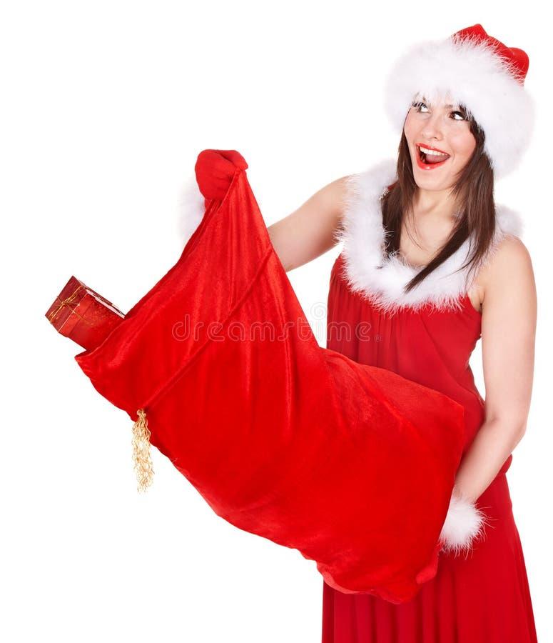 Девушка Санта Клауса и рождества с хозяйственной сумкой. стоковое изображение