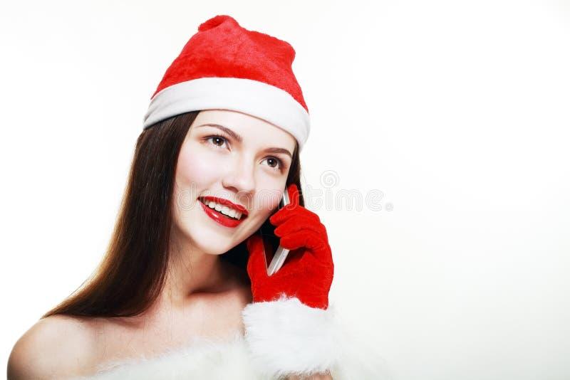 Девушка Санты с сотовым телефоном стоковая фотография