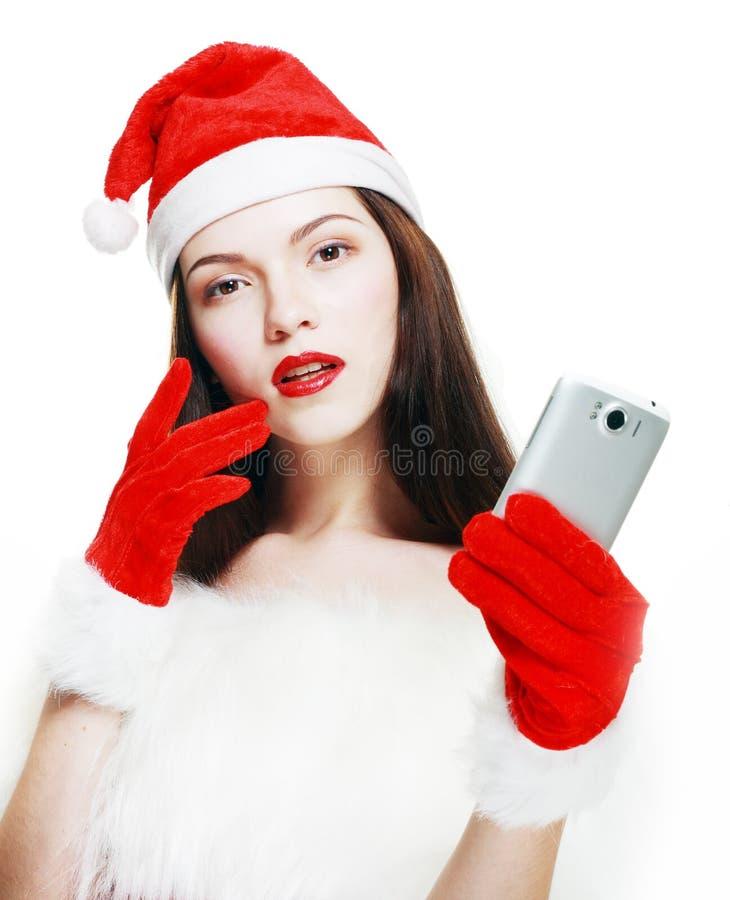 Девушка Санты с сотовым телефоном стоковое изображение