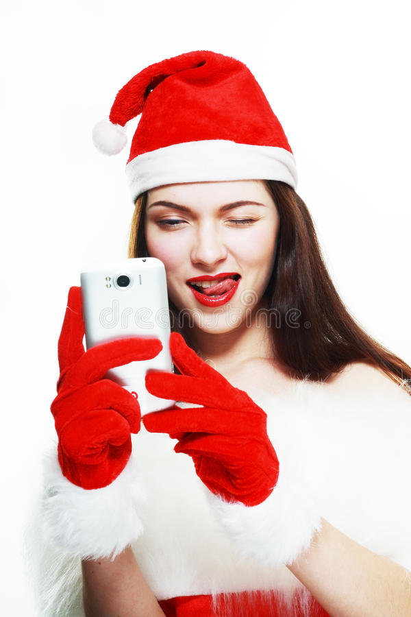Девушка Санты с сотовым телефоном стоковые изображения