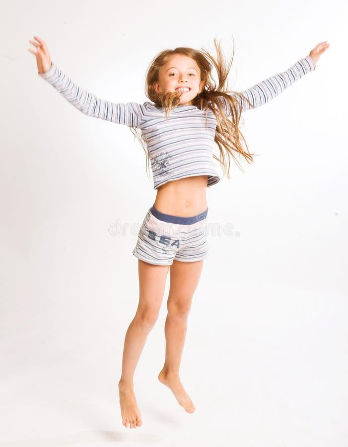 Девушка скачет на белую предпосылку стоковая фотография rf
