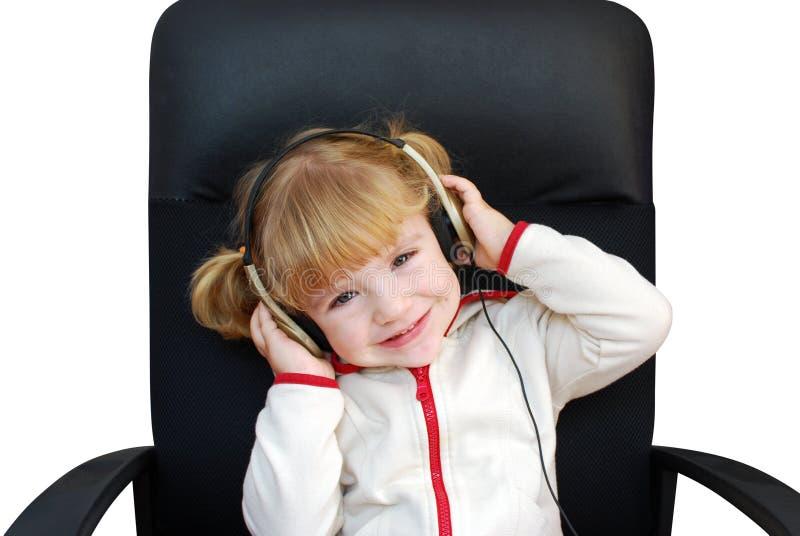 девушка слушает меньшее нот стоковое фото rf