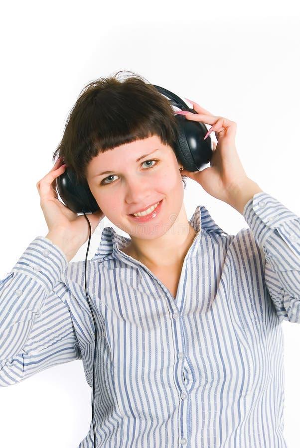 девушка слушает нот к стоковое фото rf
