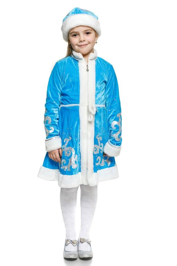 Девушка снега маленькой девочки стоковая фотография