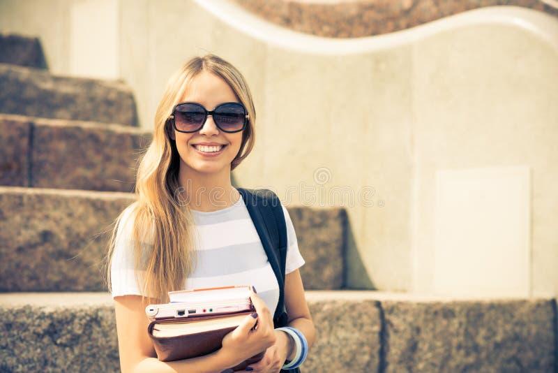 Девушка студента на лестнице стоковая фотография rf