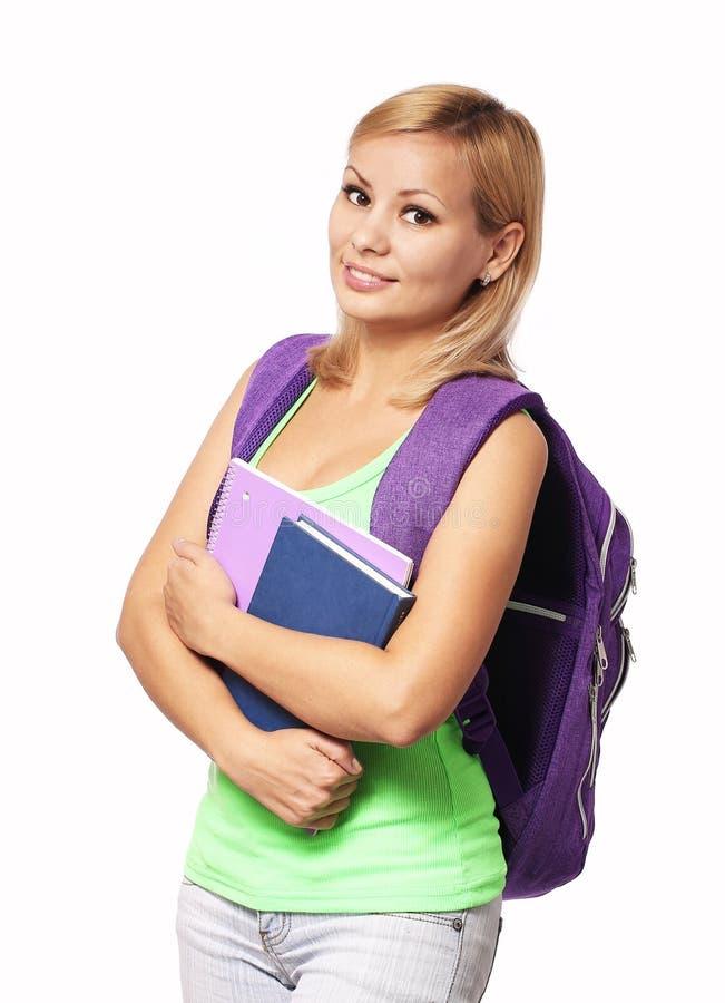 Девушка студента при изолированные рюкзак и книги стоковые изображения