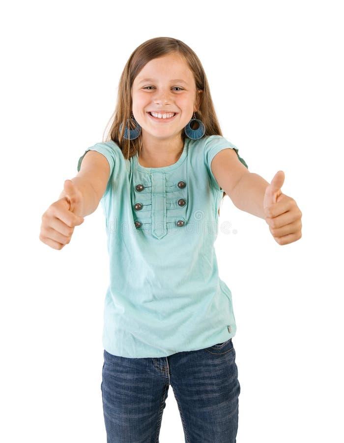 Девушка с большими пальцами руки вверх стоковое фото