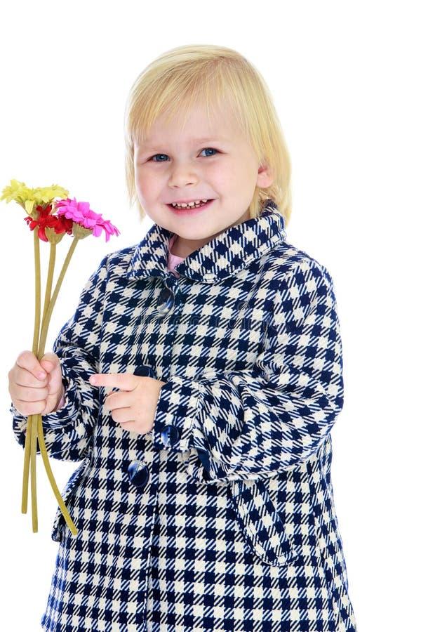 Девушка с букетом стоковая фотография