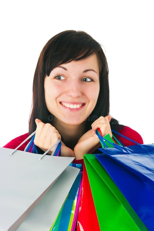Девушка с бумажными пакетами стоковые изображения