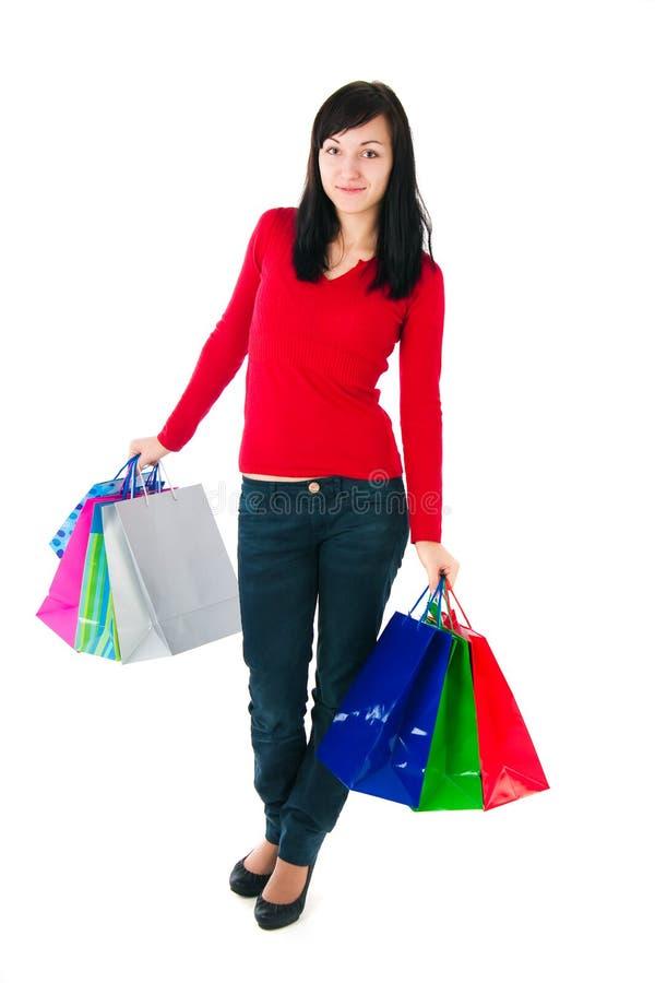 Девушка с бумажными пакетами стоковое изображение