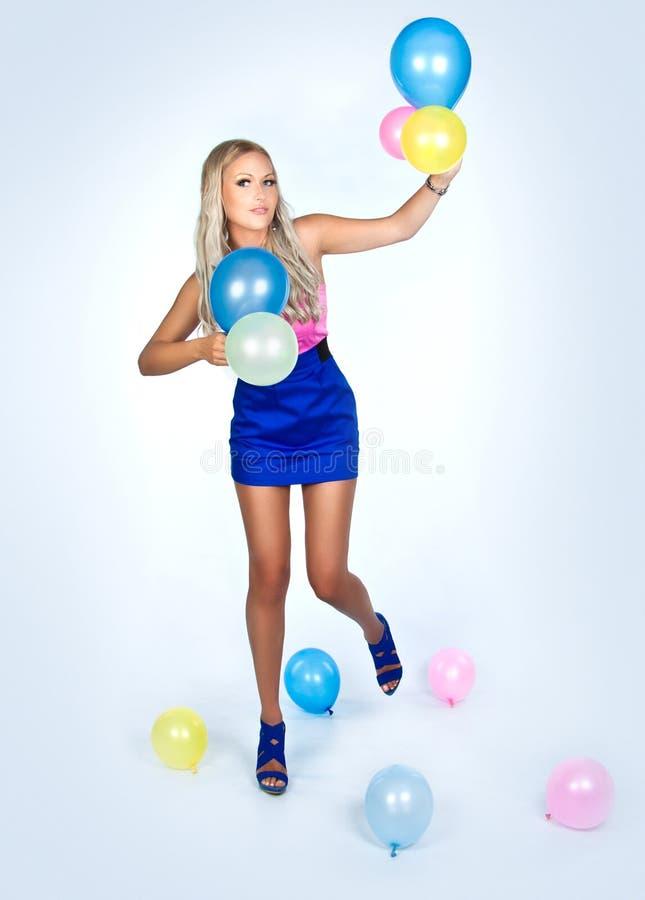 Девушка с воздушными шарами стоковое изображение