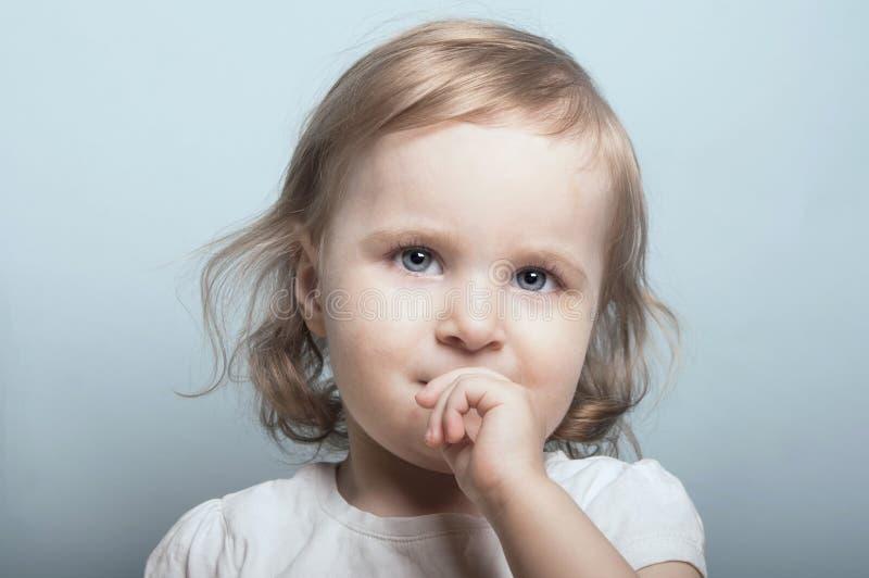 Девушка с голубыми глазами стоковое фото