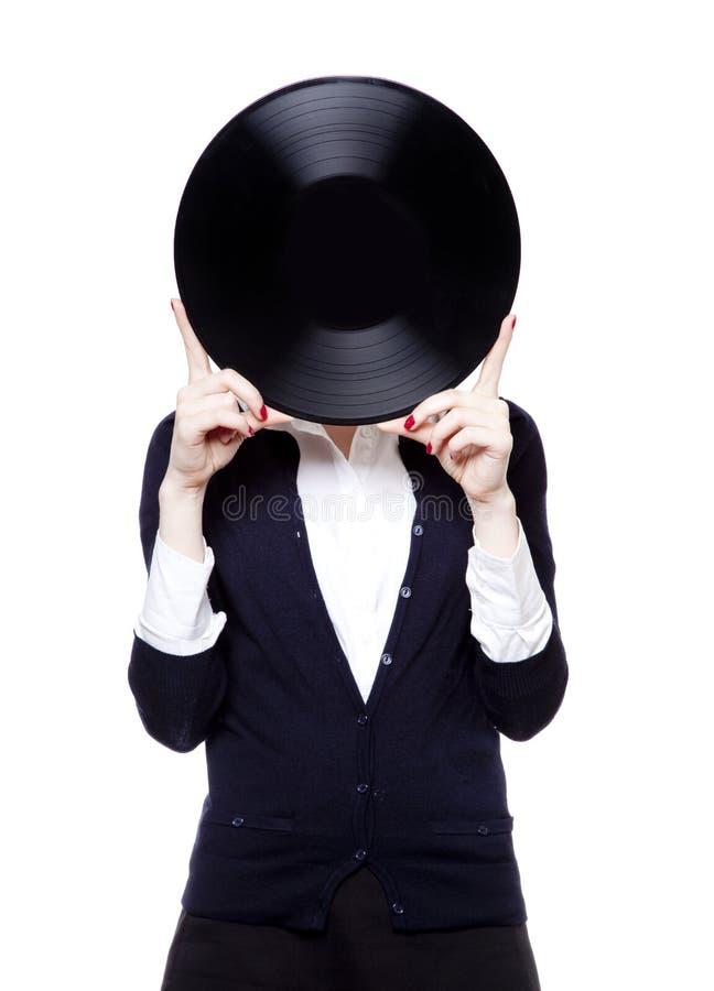 Девушка с диском vinil на белой предпосылке стоковая фотография rf