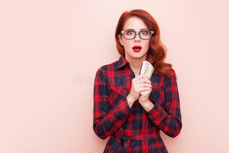 Девушка с деньгами стоковое изображение