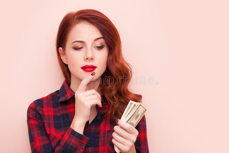 Девушка с деньгами стоковое изображение rf