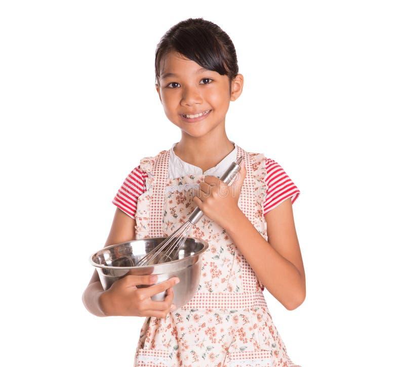 Девушка с загонщиком яичка и шаром II стали стоковая фотография