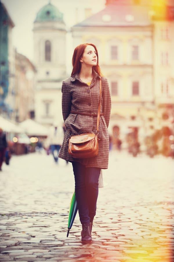 Девушка с зонтиком стоковое изображение