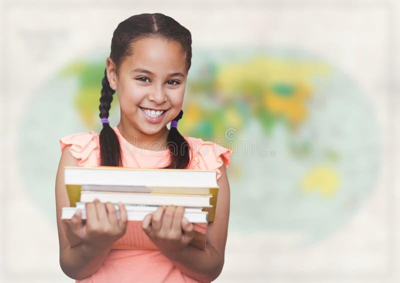 Девушка с книгами против расплывчатой карты стоковое фото rf