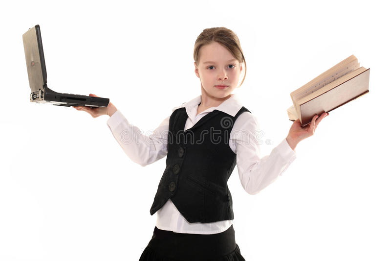 Девушка с компьютером и книгой на белой предпосылке стоковые изображения