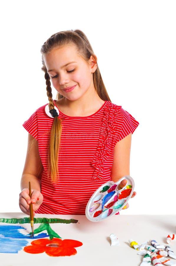 Девушка с краской над белой предпосылкой стоковое изображение rf