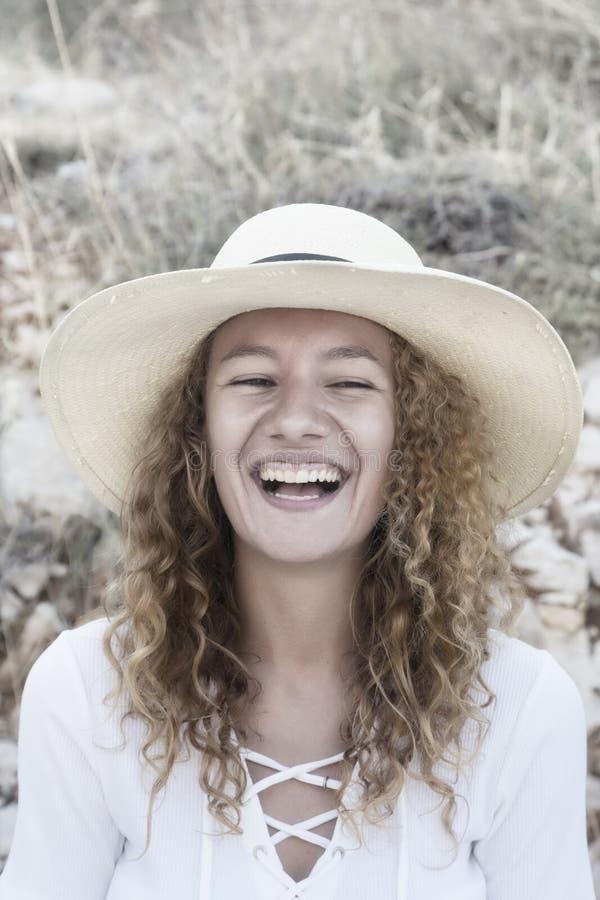 Девушка с курчавыми волосами стоковые изображения