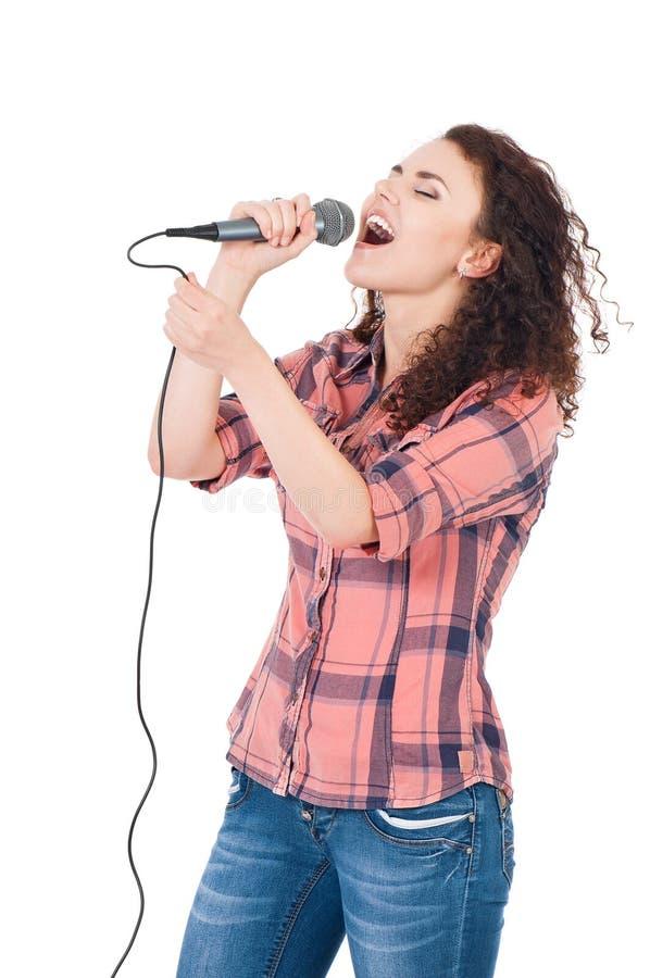 Девушка с микрофоном стоковое фото rf