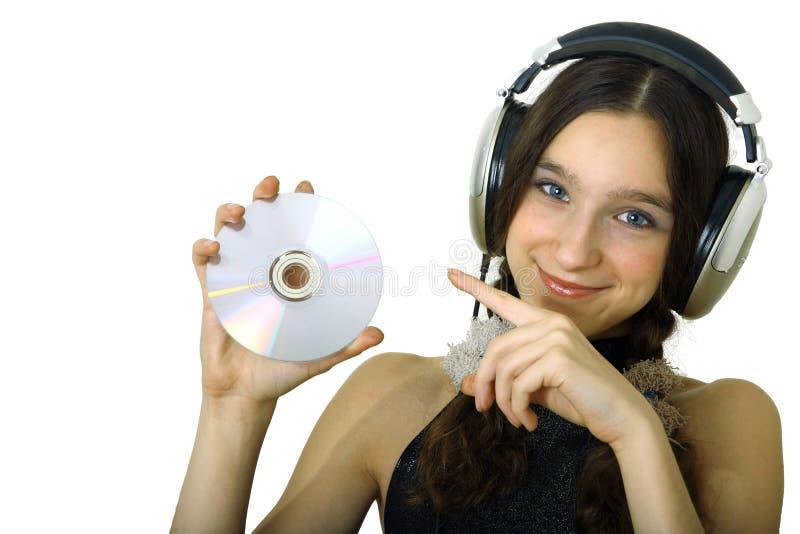 Девушка с наушниками стоковая фотография