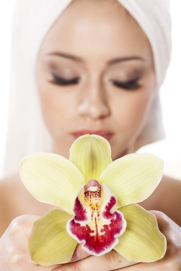Девушка с орхидеей стоковое фото