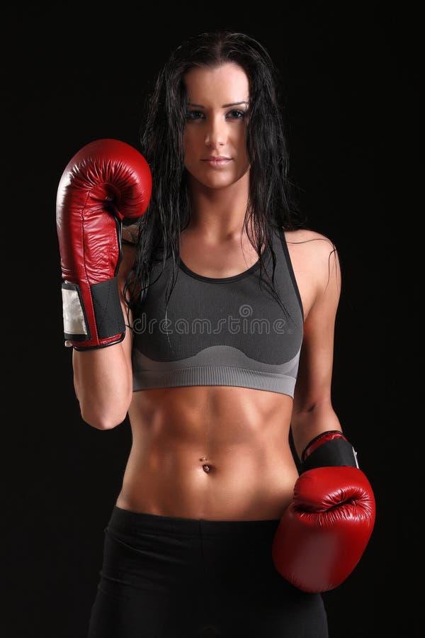 Девушка с перчатками бокса стоковое изображение